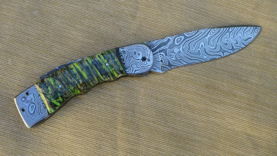 Folding knife with green mammoth tooth